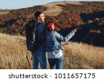 young hikers couple with... | Shutterstock . vector #1011657175