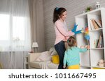 mom and daughter are cleaning...   Shutterstock . vector #1011667495