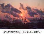 the chimneys of a refinery with ... | Shutterstock . vector #1011681892
