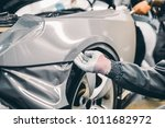 car wrapping specialist putting ... | Shutterstock . vector #1011682972