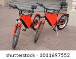 electric bikes parked in the... | Shutterstock . vector #1011697552