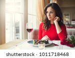 Young Woman Sitting In The...