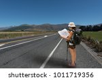 woman holding map for find the... | Shutterstock . vector #1011719356