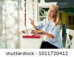young tourist girl sitting in a ... | Shutterstock . vector #1011720412