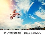 Racer On Motorcycle...