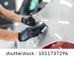 car detailing   man applies... | Shutterstock . vector #1011737296