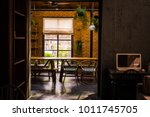 loft space design  wooden table ... | Shutterstock . vector #1011745705