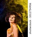 golden powder cosmetics on bare ...   Shutterstock . vector #1011754906