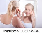 forty years old woman looking... | Shutterstock . vector #1011756658