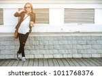 beautiful young pregnant woman... | Shutterstock . vector #1011768376