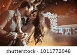 fashionable young couple posing ... | Shutterstock . vector #1011772048