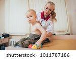 doctor woman examining...   Shutterstock . vector #1011787186