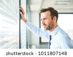 businessman looking through the ... | Shutterstock . vector #1011807148