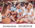 young friends enjoying a beach... | Shutterstock . vector #1011825418