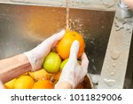 Chef Washing Citrus Fruits In ...