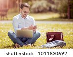 young man is sitting on the... | Shutterstock . vector #1011830692
