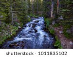 view of a creek along the blue... | Shutterstock . vector #1011835102