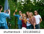 group of friends taking photos... | Shutterstock . vector #1011836812