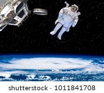 astronaut against the earth.... | Shutterstock . vector #1011841708