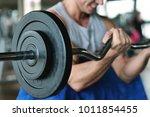a guy  wearing a tank top in a... | Shutterstock . vector #1011854455