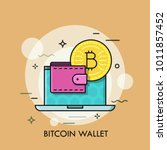 opened laptop  golden bitcoin... | Shutterstock .eps vector #1011857452