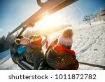 friends skiers and snowboarders ... | Shutterstock . vector #1011872782
