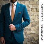 man in suit posing in front of... | Shutterstock . vector #1011878392