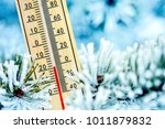 thermometer in winter weather... | Shutterstock . vector #1011879832