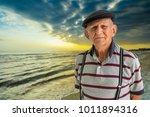 elderly 80 plus year old man... | Shutterstock . vector #1011894316