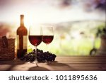 red wine bottle and glass on... | Shutterstock . vector #1011895636