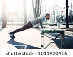 male athlete warming up before... | Shutterstock . vector #1011920416