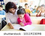 teacher teaches to write to the ... | Shutterstock . vector #1011923098