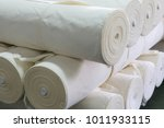 roll of white fabric for cutting | Shutterstock . vector #1011933115