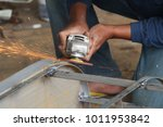 worker sawing metal with a... | Shutterstock . vector #1011953842