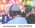 group of young people making a... | Shutterstock . vector #1011955942
