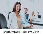 business woman with her staff ... | Shutterstock . vector #1011959545