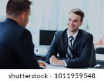 happy business people talking... | Shutterstock . vector #1011959548