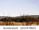 wind turbines in a desert with... | Shutterstock . vector #1011970822