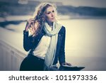 young woman with long curly... | Shutterstock . vector #1011973336