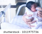 an infant was fed a bowl of... | Shutterstock . vector #1011975736