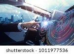 cockpit of the autonomous car... | Shutterstock . vector #1011977536