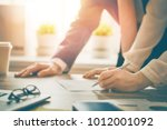 man and woman working in the... | Shutterstock . vector #1012001092