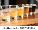 flight of craft beers in small...   Shutterstock . vector #1012003846