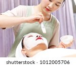 asian beautician applying white ... | Shutterstock . vector #1012005706