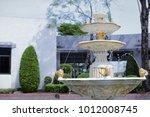 garden fountains in park... | Shutterstock . vector #1012008745
