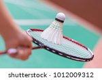 kid holding badminton racket... | Shutterstock . vector #1012009312