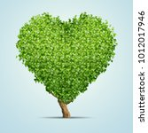 green tree shaped in heart... | Shutterstock . vector #1012017946