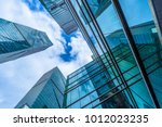 modern office building against... | Shutterstock . vector #1012023235
