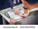 Small photo of Businessman Describe and Sign Contract to Join with Partner - Business Concept