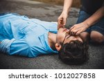 Small photo of CPR First Aid on A Man Who has Senseless, Breathing Difficulties ,One Part of the Process Resuscitation - Healthcare Concept